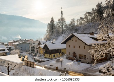 ZELL AM SEE, AUSTRIA - FEBRUARY 4, 2018 : Winter view across snow covered buildings in the Austrian Ski Resort of Zell Am See in the state of Salzburg.