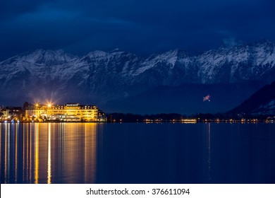 "ZELL AM SEE, AUSTRIA - JANUARY 05, 2016 - Grand Hotel in front of Steinernes Meer (""Rocky Sea"") mountain range at wintertime"