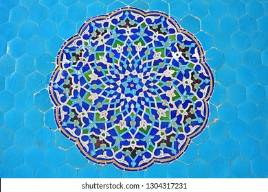 Zellige, mosaic tilework made from individually chiseled geometric tiles, with elaborate Islamic geometric patterns, in the historic Jame Mosque of Yazd (Iran)