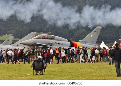 ZELTWEG, AUSTRIA - JULY 01: crowd of spectators and different jets by airshow - airpower11 - on July 01, 2011 in Zeltweg, Austria
