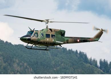 Zeltweg, Austria - September 6, 2019: An Austrian Air Force Bell UH-1N Twin Huey helicopter flying at the Zeltweg Air Base in Austria.