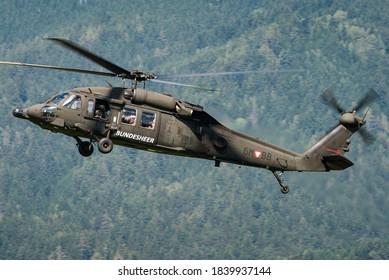 Zeltweg, Austria - September 6, 2019: An Austrian Air Force Sikorsky S-70 (UH-60) Black Hawk 6M-BB helicopter flying at the Zeltweg Air Base in Austria.