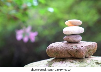 Zen or balance concept, pebbles or stones stacked up outdoors