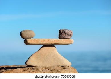 Zen balance of stones on coast