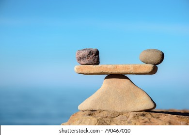 Zen balance of stones at seashore