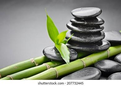 zen basalt stones and bamboo on the black