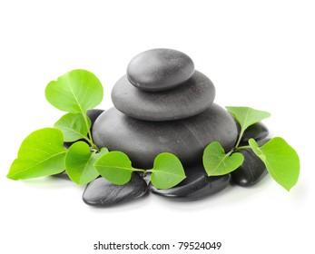 zen basalt stones and leaves
