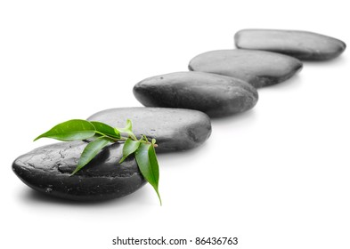 zen basalt stones and leaves on the white