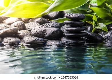 zen basalt stones and water