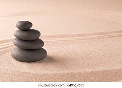 zen budhism meditation pile of stones on sand. Paterns for yoga, relaxation and concentration.