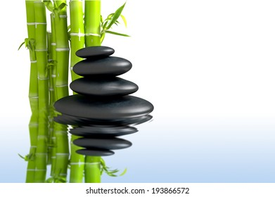 Zen concept with bamboo and black stones