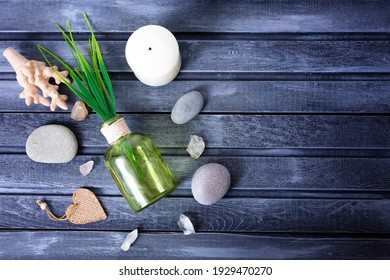 Zen concept, spa pebbles stones shells on a wooden background, aromatherapy and massage treatment, copy space for text. High quality photo
