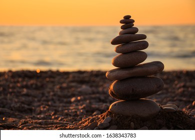 Zen concept. Sunset. The object of the stones on the beach at sunset.  Relax & Meditation. Zen stones.