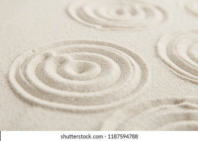 Zen drawing on white sand. Concept of harmony, balance and meditation, spa, massage, relax