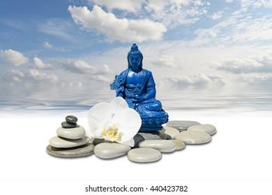 Zen or Feng-Shui background-Blue Medicine Buddha Bhaisajyaguru,zen stone,white orchid flowers and sky reflected in water