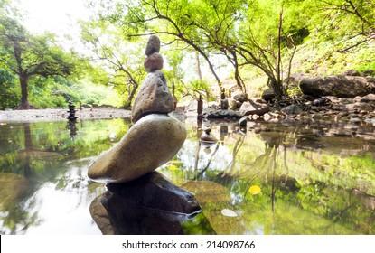 Zen garden. Meditate spiritual landscape of green forest with calm pond water and stone balance rocks