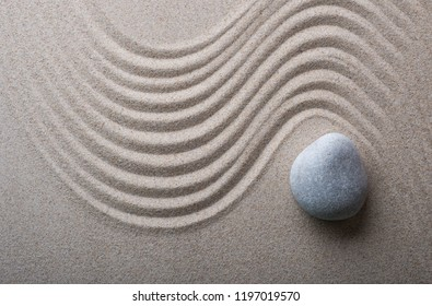 zen garden meditation stone background. Stones and lines in the sand for the balance of relaxation and harmony of spirituality or spa health