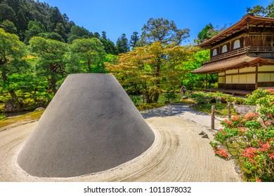 Zen garden sand tower named Kogetsudai, representing Fuji montain in Ginkaku-ji Temple. Ginkakuji or Silver Pavilion, officially named Jisho-ji, is a Zen temple in Kyoto, Japan. Spring season.