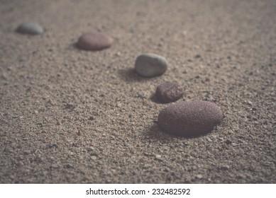 zen garden sand waves and rock sculptures. Vintage photography effect.