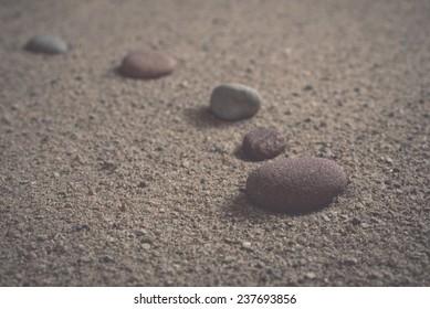 zen garden sand waves and rock sculptures - retro, vintage style look