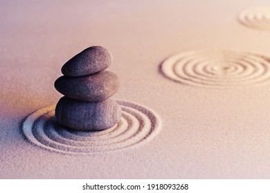 Zen garden stones on sand with ornament