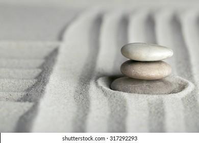 Zen garden stones images stock photos vectors shutterstock zen garden with stones on sand background workwithnaturefo