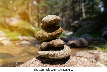 Zen meditation background, balanced piles stacked in river water