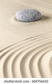 zen meditation stone and sand pattern.