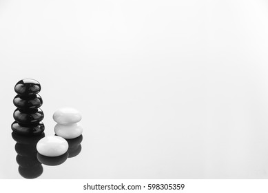 Zen pebbles balance.Stack of black stone.Spa and healthcare Background concept.