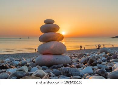Zen Pebbles on a beach sunset inspiring relaxing