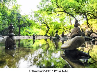 Zen pond in forest. Photography of stone towers, peace and calm concept
