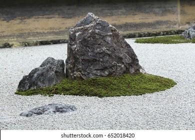 Zen Rock Garden in Ryoan-ji Temple.In a garden fifteen stones on white gravel, Kyoto, Japan