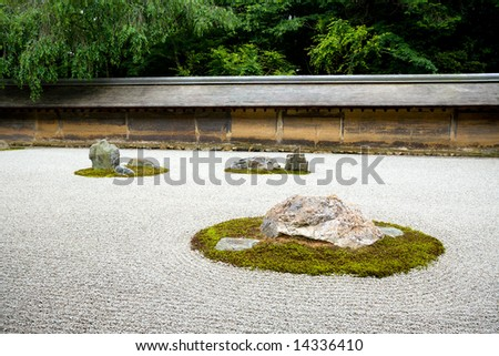 A Zen Rock Garden in Ryoanji Temple.In a garden fifteen stones on white gravel. Kyoto.Japan.