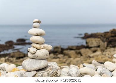 Zen rocks stacked near to the ocean