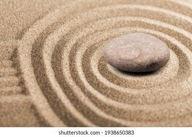 Zen sand garden with meditation stone for relaxation. Concept of harmony, balance