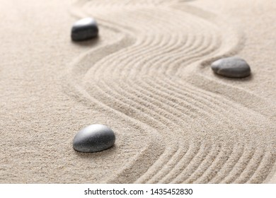zen ston on raked sand with copy space for your text