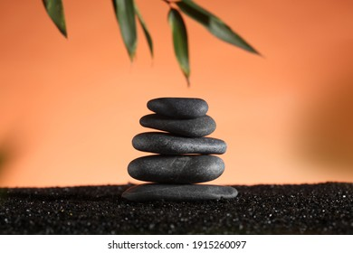 zen stone concept: piled stones and a bamboo  branch with copy space for your text