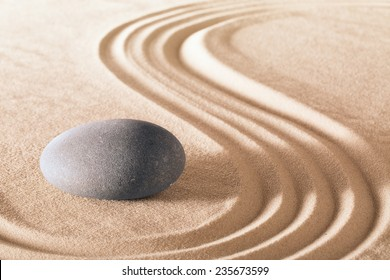 zen stone garden round stone and raked sand making line patterns tranquil scene for relaxation and meditation simplicity and balance are the base of a Japanese garden nice calm spa background