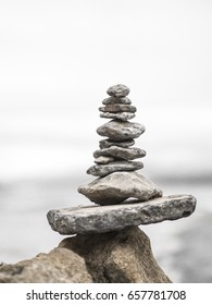zen stone. Stones in balance in a quiet composition with the background beach that inspires and invites well-being