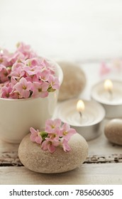 Zen stones, aromatherapy candles and flowers