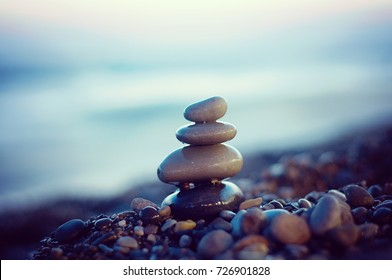 Zen stones balance. Harmony and peace silence. Rocks on the coast of the sea. Stock Photo.
