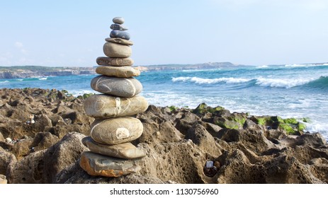 zen stones in balance on beach