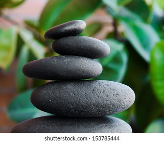 Zen stones and green leaves