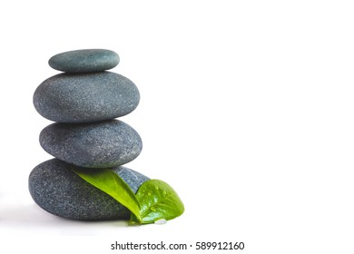 Zen Stones and green leaves on white isolated background. SPA background. SPA or harmony concept. Tranquility