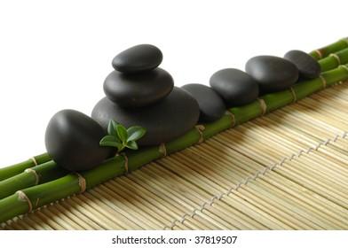 zen stones on the bamboo stems