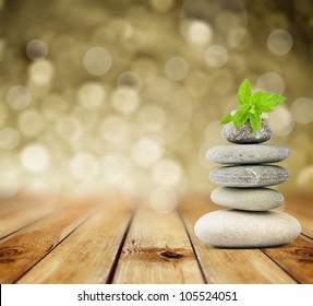 zen stones on the old wooden background