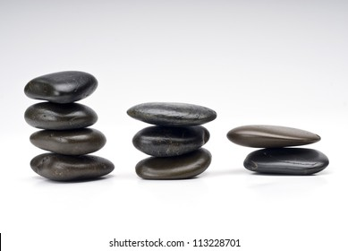 Zen stones on paper with reflection and shadow