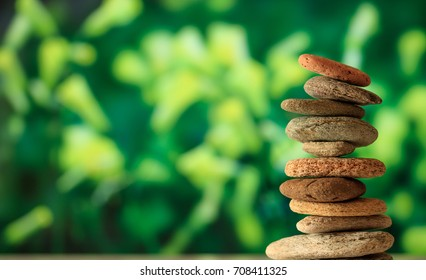 Zen stones stacked on abstract nature background