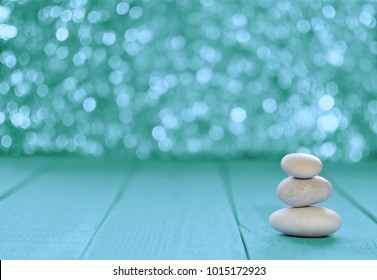 Zen Stones / Zen stone on wooden and   aquamarine bokeh abstract background  for perfect meditation. space for text.