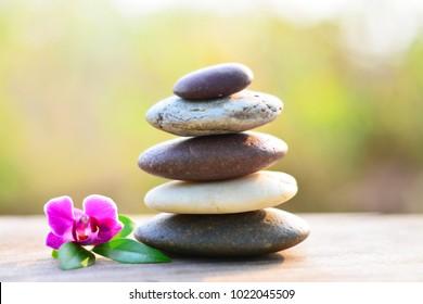 Zen stones and vanda orchid on wooden floor middle position.